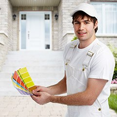 Man holding paint color samples