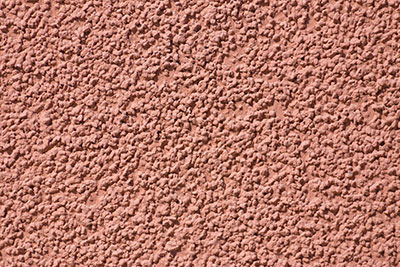 Tan colored popcorn on wall surface