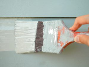 Arlington painting company considers the weather's effect on outdoor paint.