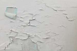 Wall with cracked and peeling paint