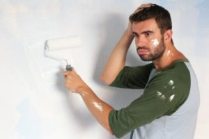 man making a mistake on exterior painting