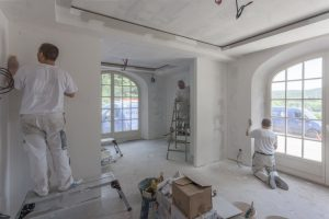 a painting team painting the inside of a house