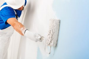 a professional painter painting a home's walls