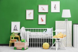 a children's room with green walls